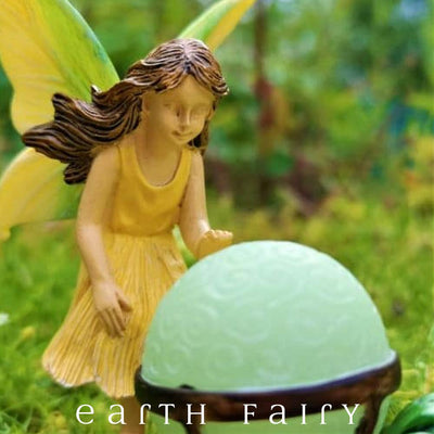 "Fairy with Glowing Orb, Displayed in a Garden Setting, from The Woodland Knoll ""Glow in the Dark"" Fairy Garden Collection by Earth Fairy"