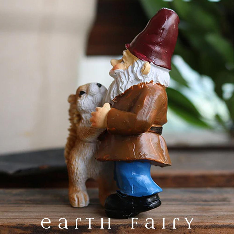 Gnome, with Blue Pants, Brown Coat, Red Hat and White Beard posed dancing with a Squirrel