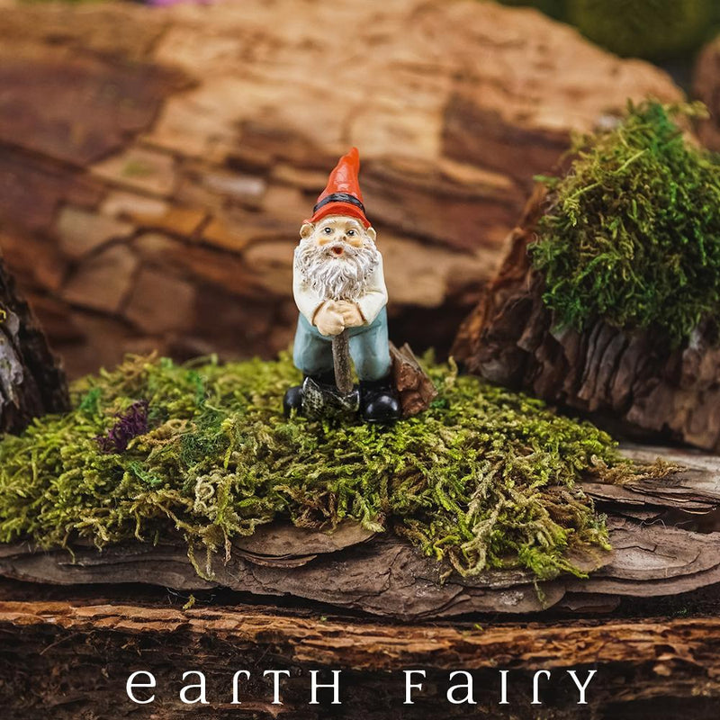 Miniature polyresin gnome figurine, posed with hatchet, black boots, blue pants, cream top and pointy red hat