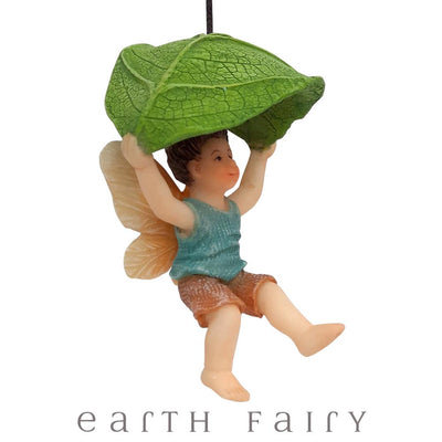 Leaf Parachute Boy Fairy, Side View, from The Miniature Fairy Garden Figurine Collection from Earth Fairy