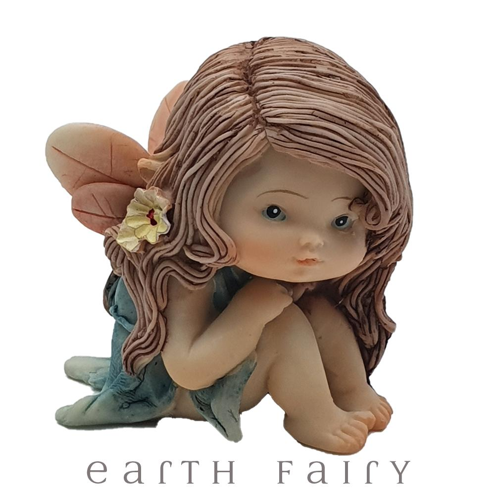 Little Fairy Sitting, small fairy with her hands clasped under her chin, sitting position, long brown hair