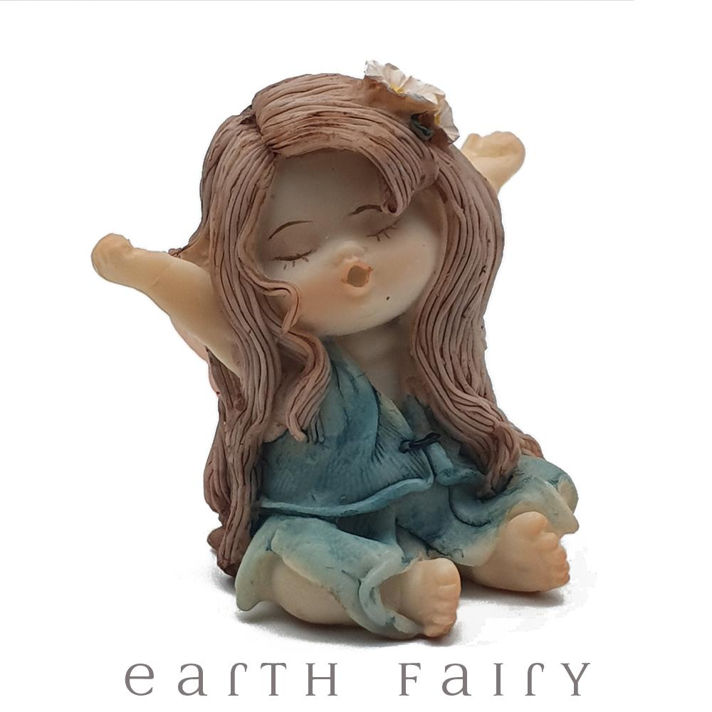 Little Fairy Yawning, small fairy with a blue/green dress, arms outstrecthed, eyes closed, and yawning.