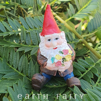 Sitting Gnome Holding Flowers, Garden Setting, from The Miniature Fairy Garden Gnome Collection by Earth Fairy