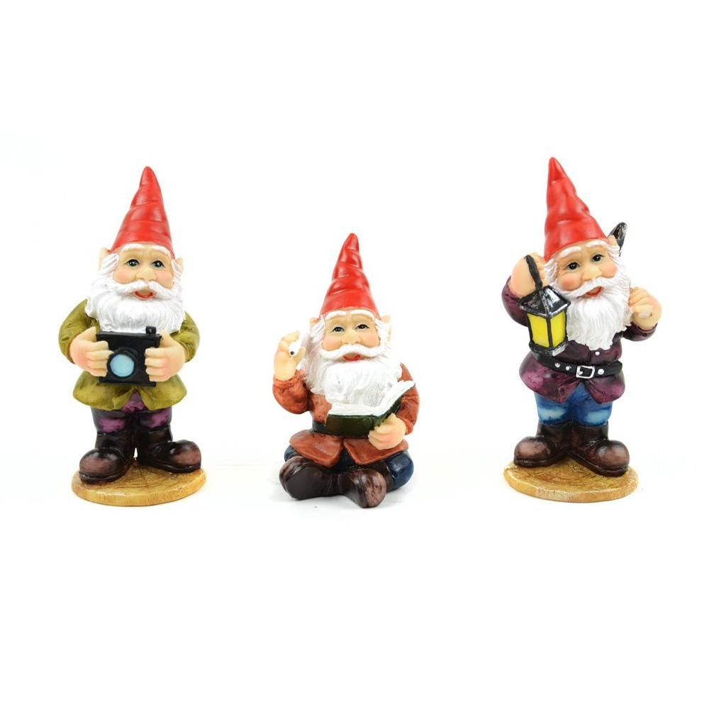 set of 3 miniature gnomes, gnome photographer, gnome librarian and gnome miner, all posed with tools of their trade