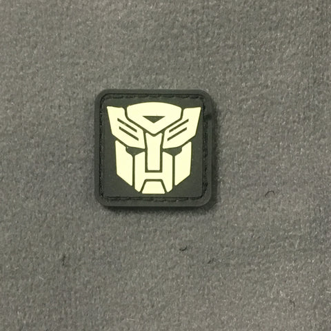 AUTOBOTS PVC GITD CAT EYE MORALE PATCH - Tactical Outfitters