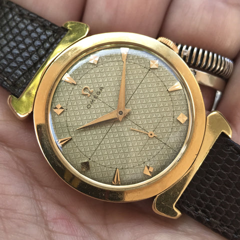 "Omega - 18 kt yellow gold case ""hooded lugs"" Guilloché dial"