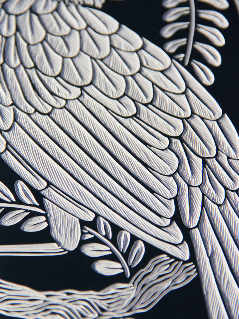 Close up of 'Huia on Kowhai' by Hannah Jensen. Hand-carving in 41 layers of acrylic paint on sustainably grown macrocarpa.