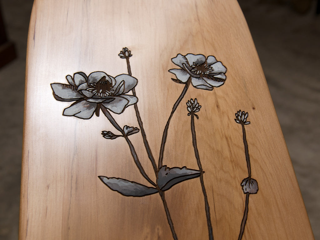 Close up of 'Mt. Cook Lily' hand-painted by HH (Hannah Heslop) onto a laser etched recycled rimu board handcrafted by The Paper Rain Project.