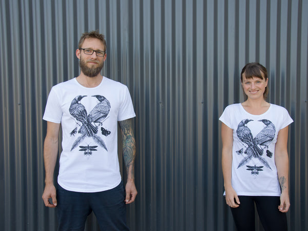 The Paper Rain Project's men's and women's Two Tui T-shirt. Designed by FLox and supporting The Wildlife Hospital, Dunedin. Fair trade and organic t-shirts in white.
