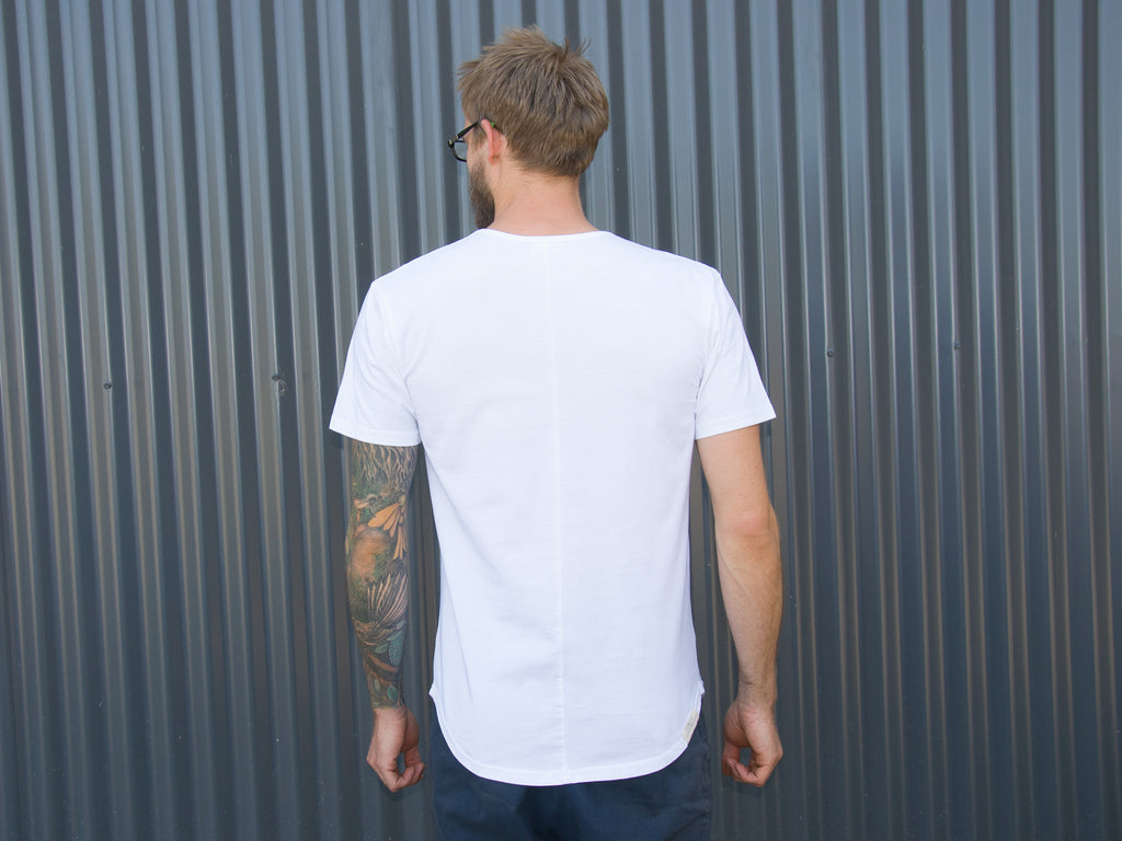 Back of men's white fair trade, organic tailor T-shirt by The Paper Rain Project.