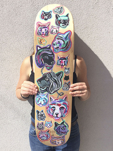 'Study of a Tiger' hand-painted by Mica Still acrylic and ink on maple skateboard.