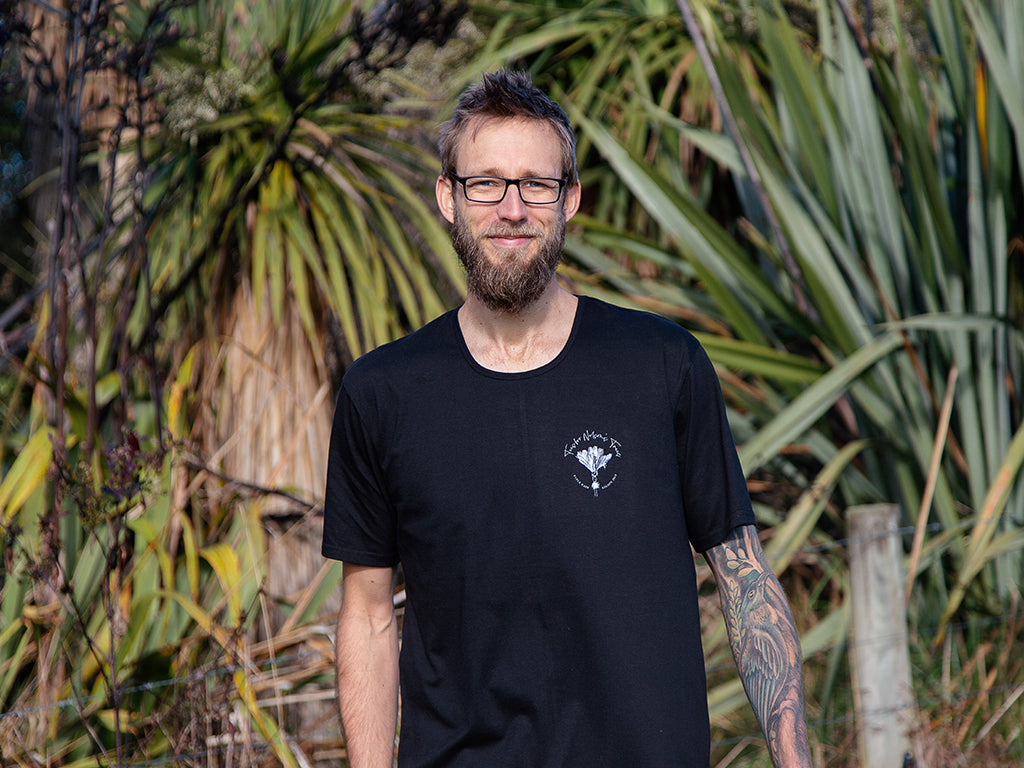 Men's black Tees for Nelson's Trees T-shirt by The Paper Rain Project. Raising money for the revegetation of Nelson's forests after devastating forest fires.
