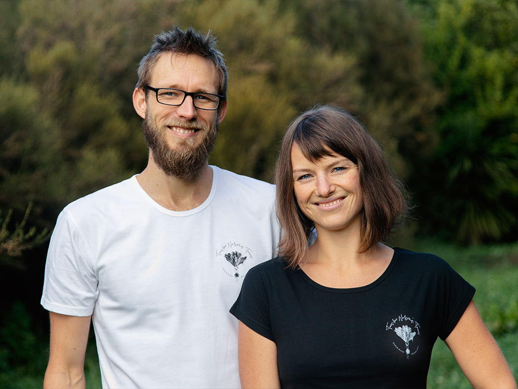 Men's and women's Tees for Nelson's Trees t-shirt, in black and white, by The Paper Rain Project. All net profits to be donated to revegetation of the Nelson region.