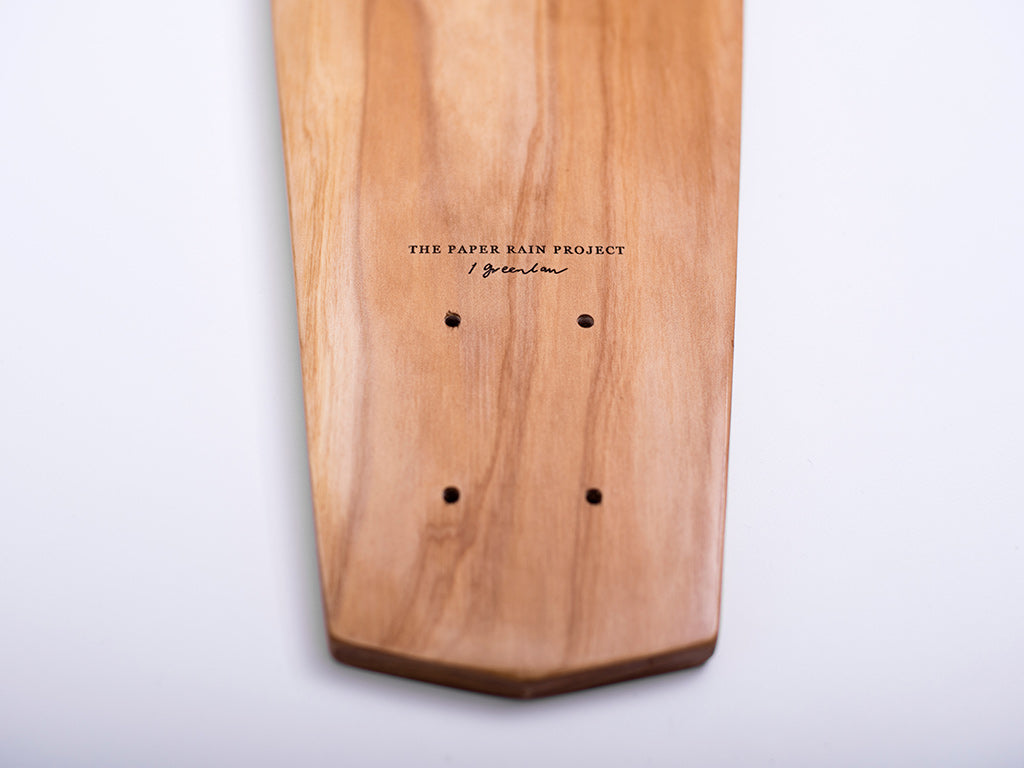 Lower half of 'Tui' designed by Indigo Greenlaw, laser etched onto a macrocarpa art board crafted in-house at The Paper Rain Project.
