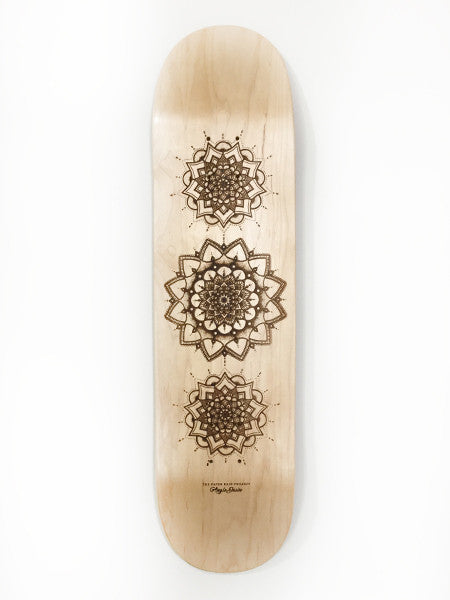 Laser etched mandala on skateboard by Angie Dawn