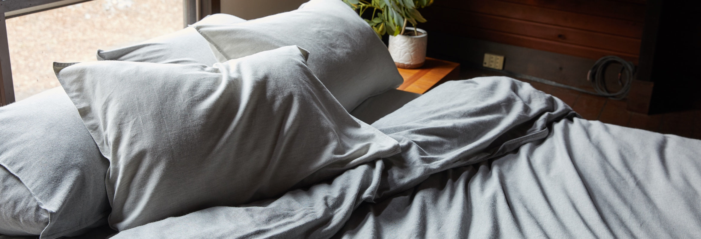 Couple in bed made up in Heathered Cashmere