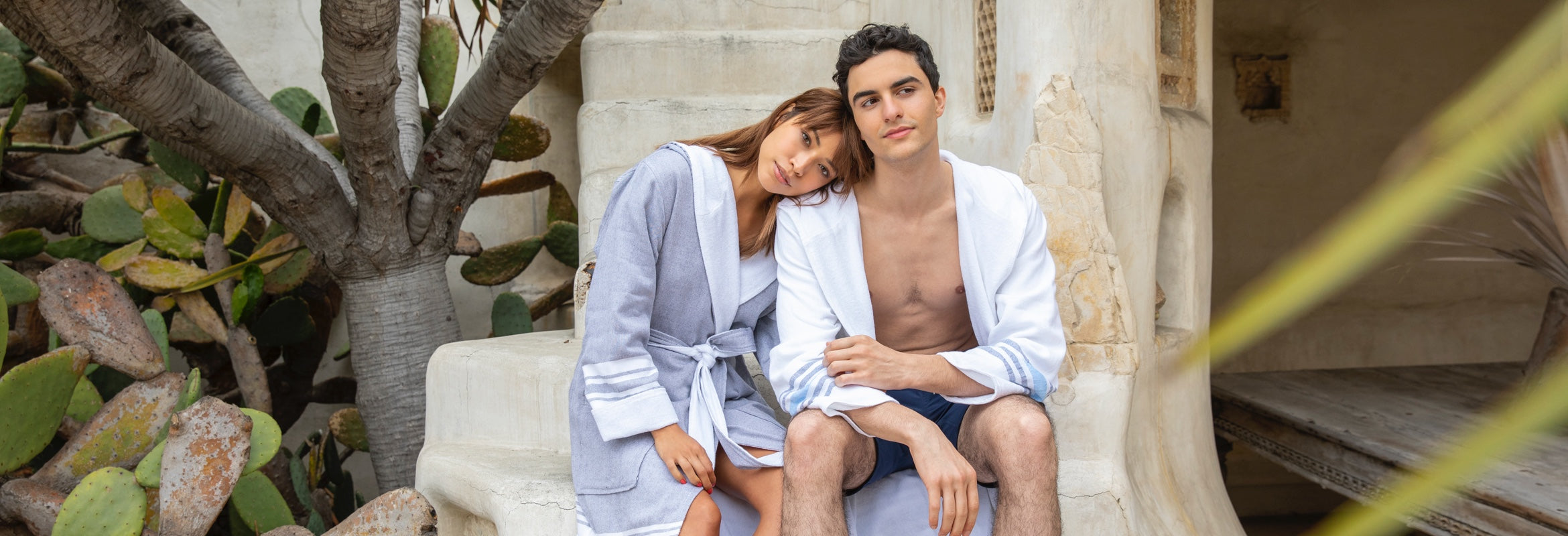 Happy couple lounges together in Hammam robes.