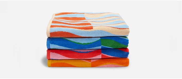 Stack of four Beach Towels in assorted colors.