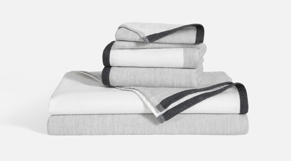 Stack of two Melange Colorblock Towels and two Melange Colorblock Hand Towels