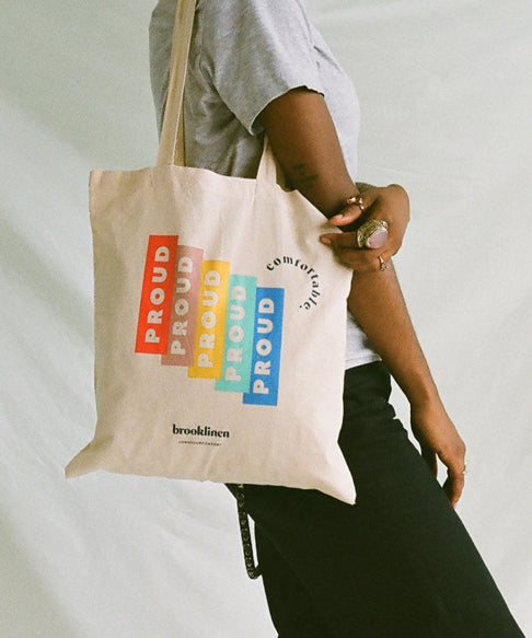 2 arms holding a proud tote