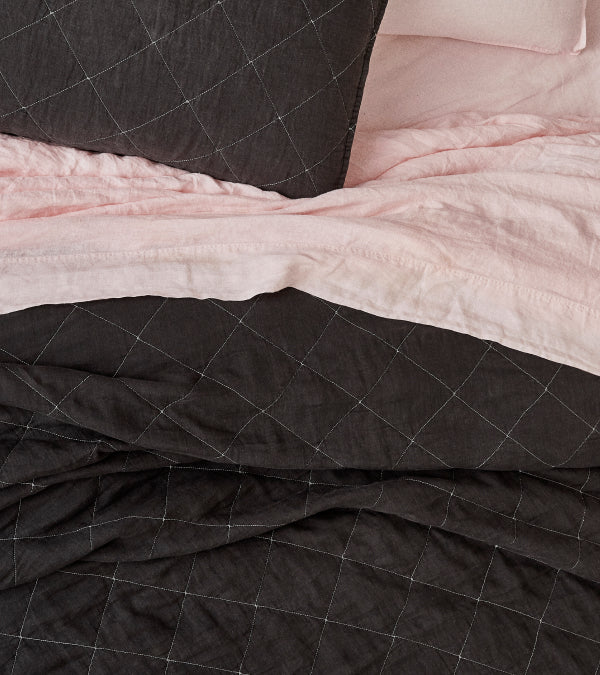 Pink linen sheets with a grey linen quilt