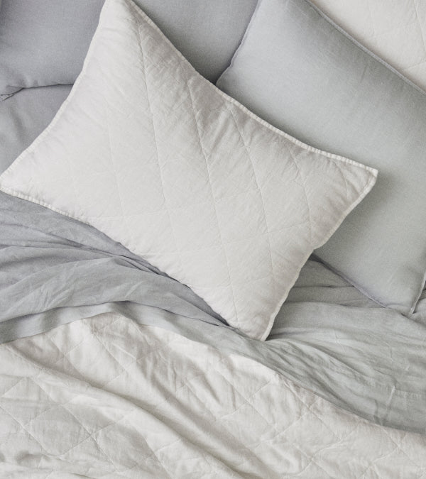 White linen shams and heathered cashmere sheets