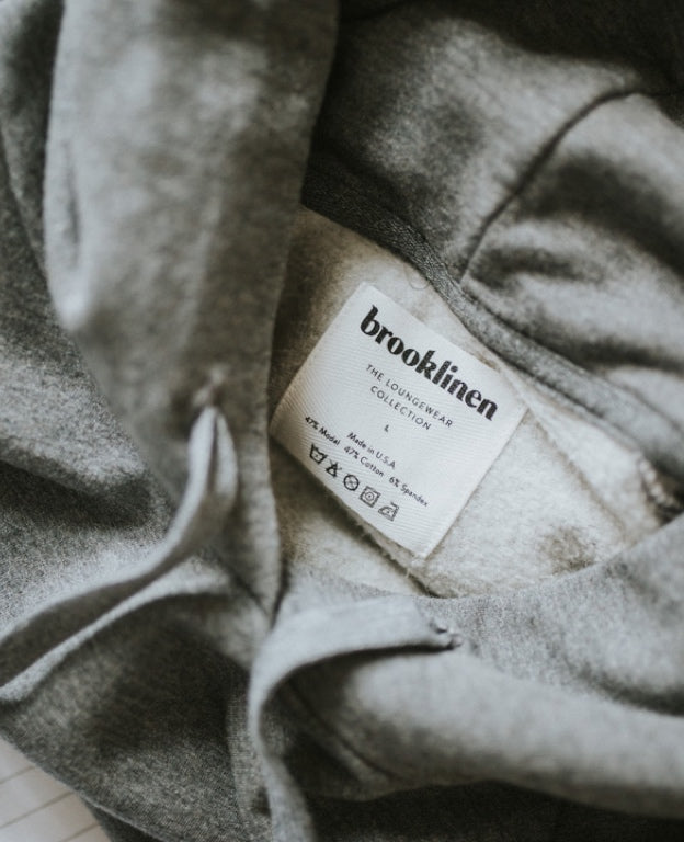 A close up detail of the inside of a gray brooklinen hoodie