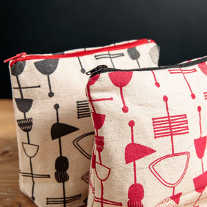 hand screen printed pouch mid century inspired black with a red zip and red with a black zip