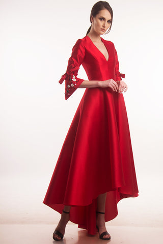 Red V-neck ball gown with appliqués