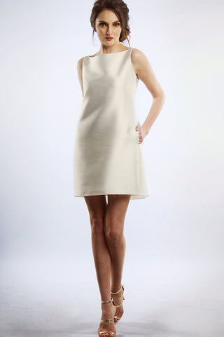 White shift dress with back pleats and zip detail