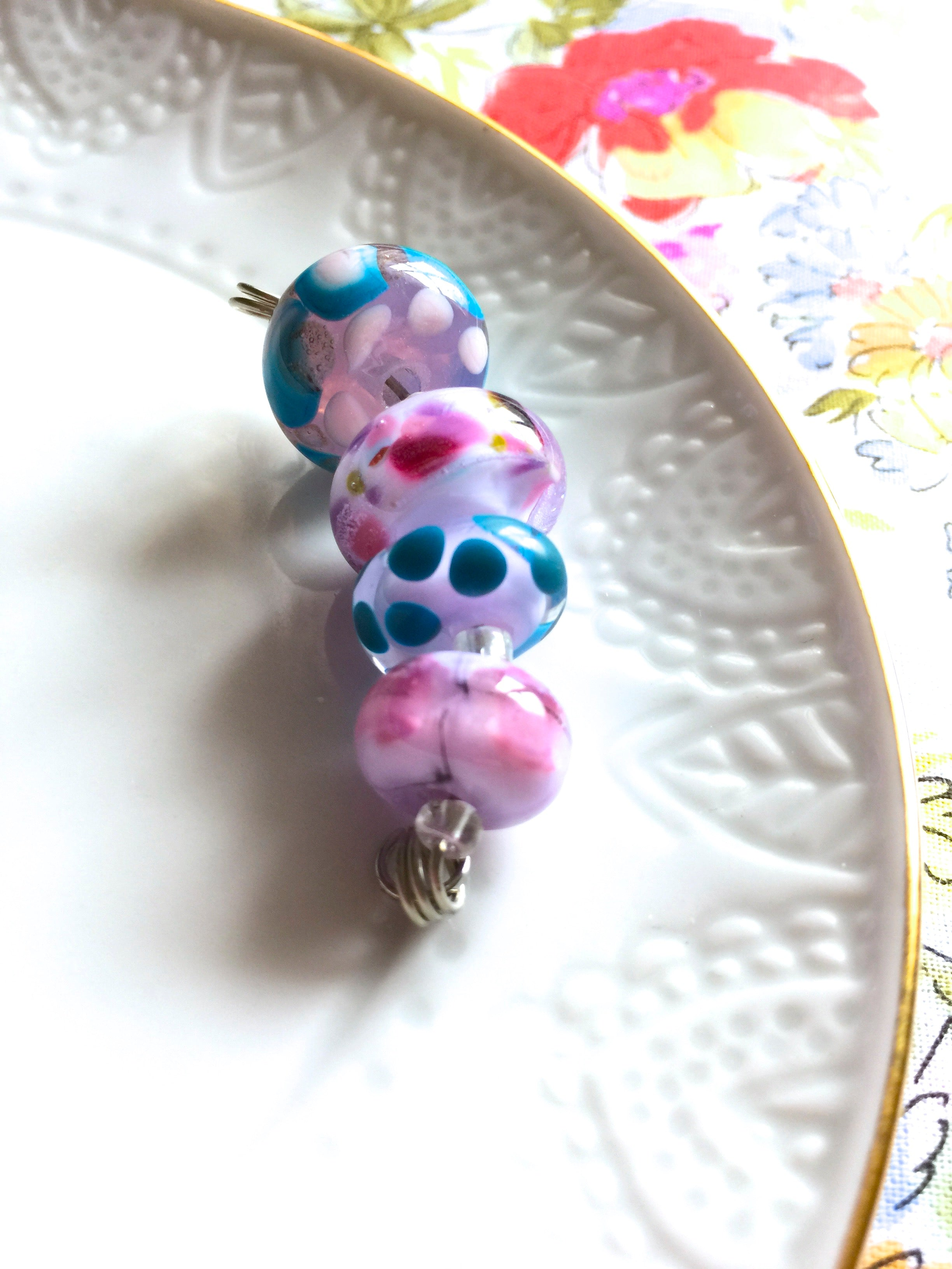 Set of 4 Handcrafted Lampwork Glass Beads in shades of Pink, Blues, Violet with spots and swirls.