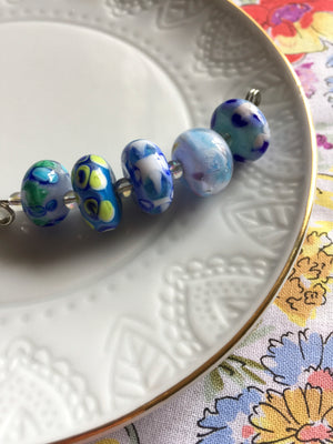 Set of 5 Handcrafted Lampwork Glass Beads in shades of Blues.