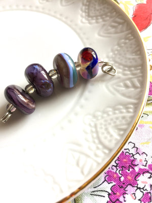 Set of 4 Funky and Unique Handcrafted Lampwork Glass Beads in purples and blues.