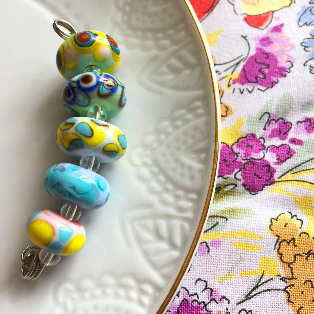 Set of 6 Handcrafted Lampwork Glass Beads in pretty mix of pastels and bright dots.