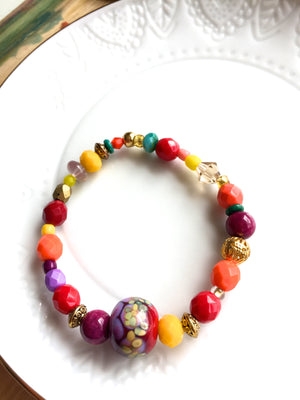 Colorful Czech glass, lampwork & gemstone bead bracelet in autumn reds, yellow, orange, and purple