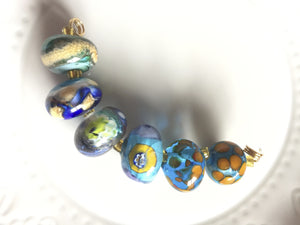 Set of 6 Handcrafted Lampwork Glass Beads in shades of Blues.