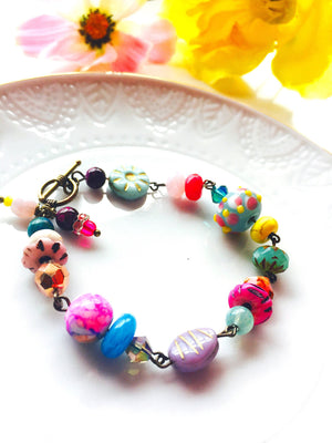 Hot pink, mint,yellow, violet beaded bracelet