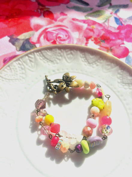 Gorgeous colorful glass beaded bracelet with antiqued links and floral clasp. Pretty bright spring inspired colors.