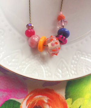 Fun and colorful handcrafted glass and stone necklace. One of a kind jewelry for spring and summer.