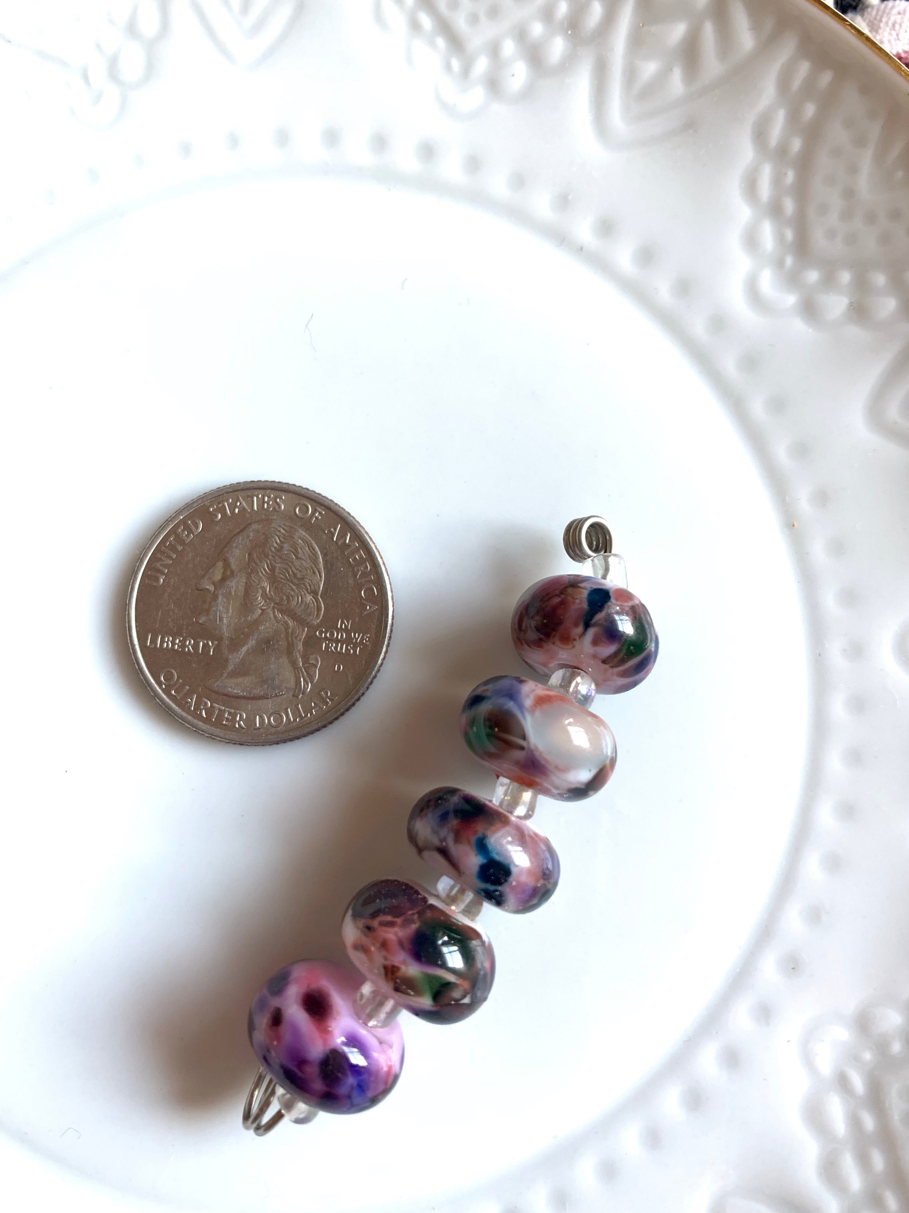 Set of 5 small rondelle shaped lampwork beads in deep shades of violet