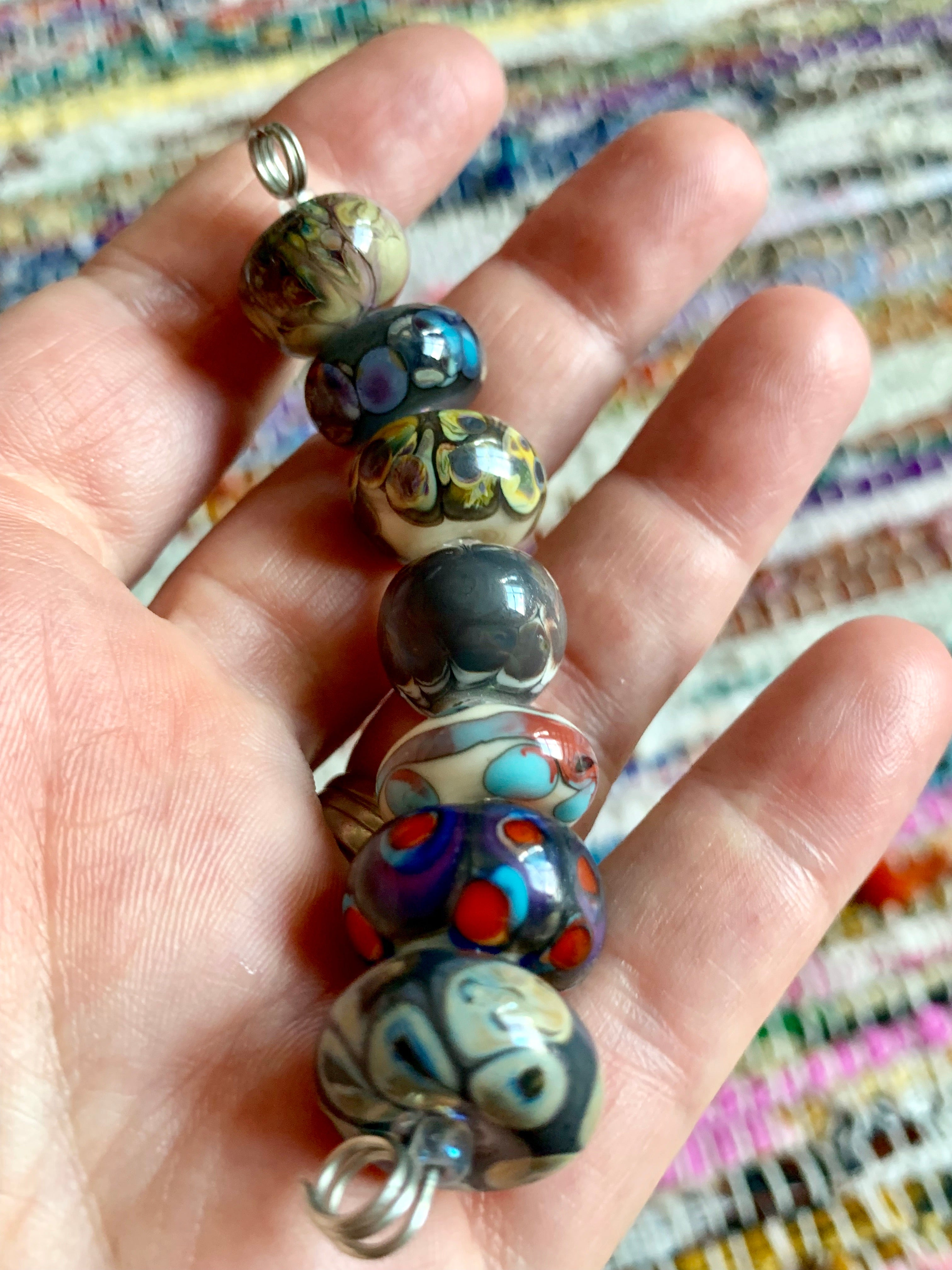 Set of 7 mixed rondelle lampwork beads in various neutral tones