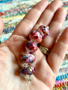 Set of 5 handcrafted light pink lampwork glass beads with beautiful speckles.