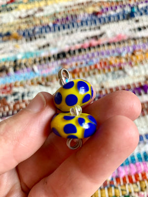 Set of 2 yellow and royal blue polka dot lampwork glass beads