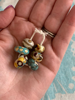 Set of 6 Handcrafted Lampwork Glass Beads in ivory, turquoise, browns, and golden yellow.