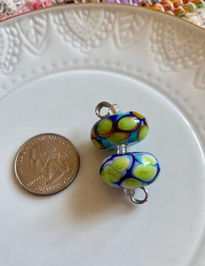 Set of 2  spotted lampwork beads in sky blue, lime, royal blue, and orange.