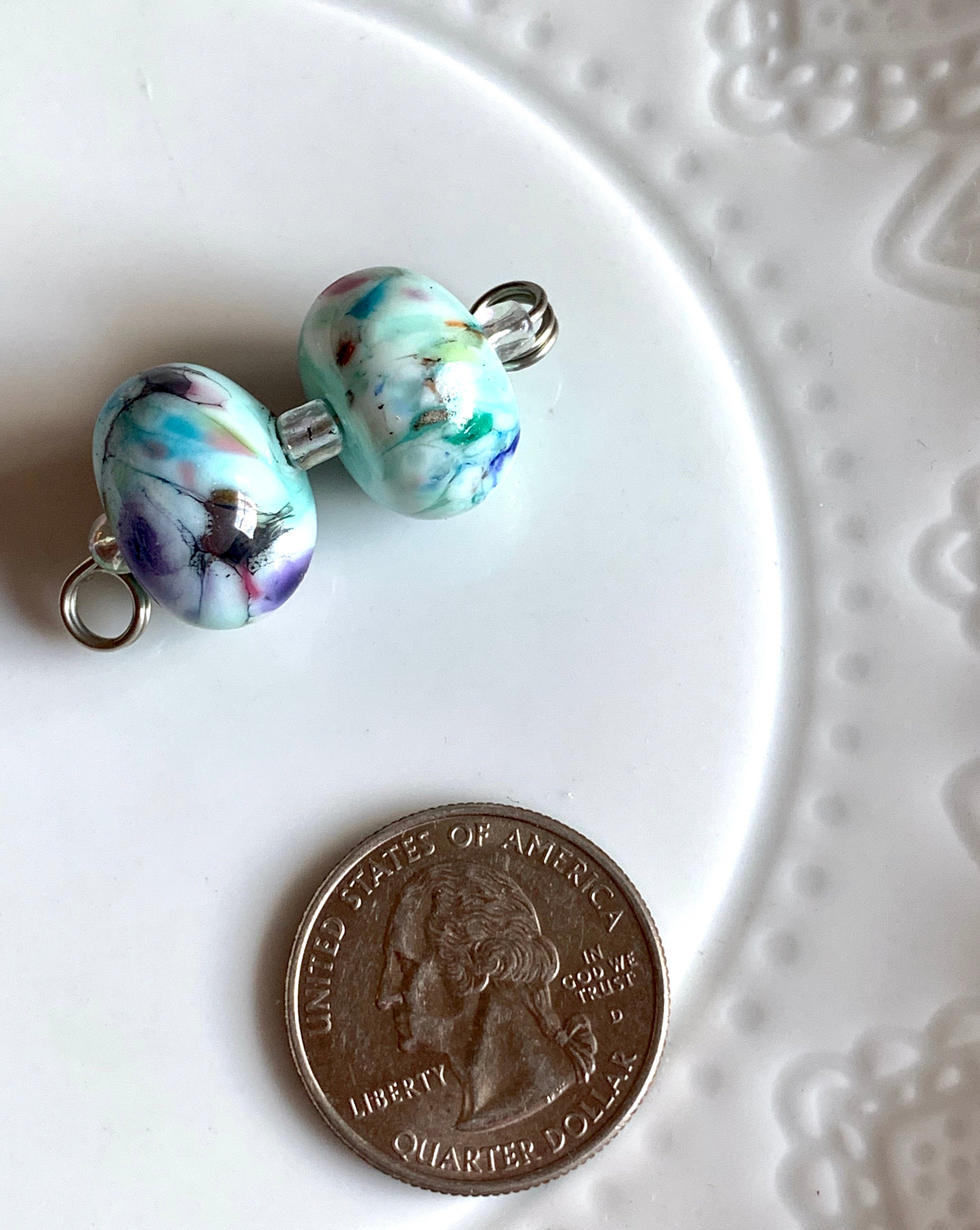 Set of two swirly lampwork glass beads in mint, blue, violet, green