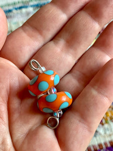Set of two polka dot lampwork glass beads in bright orange & turquoise