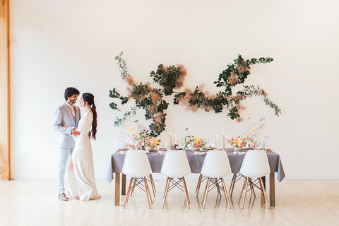 Modern reception table setting and white chairs