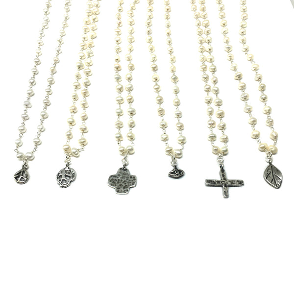 Plump Cross Necklace on Pearl Chain