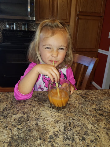 Piper drinking her veggie juice